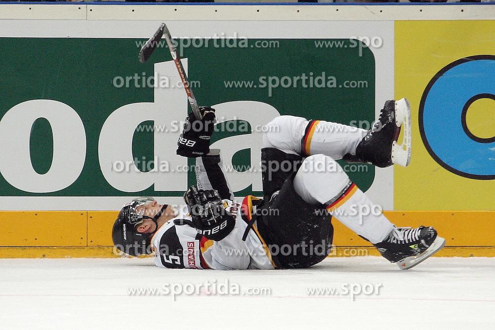 22.05.2010, Lanxess Arena, Koeln, GER, 74. IIHF WM, Halbfinale, Deutschland ( GÉR ) vs Russland ( RUS ) im Bild: Korbinian HOLZER ( GER / Duesseldorf #5 ) liegt nach einem Check von Nikolai KULEMIN ( RUS #41 / Toronto ) benommen auf dem Eis  EXPA Pictures © 2010, PhotoCredit: EXPA/ nph/   Florian Mueller / SPORTIDA PHOTO AGENCY