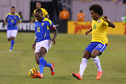 Sep 9, 2014; East Rutherford, NJ, USA; Ecuador defender Walter Ayovi (10) plays the ball while being defended by Brazil midfielder Willian (19) during the first half at MetLife Stadium.