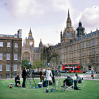 UK. London. From a story on Abingdon Street Gardens, a small patch of land, often referred to as College Green, that lies next to The Houses of Parliament in Westminster. It is a place where the media and the politicians come face to face. Interviews are held, photo shoots are set up and bewildered tourists stroll by..Photo shows the square on the day of the 2005 General Election..Photo©Steve Forrest/Workers Photos