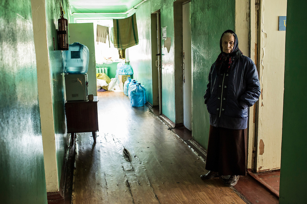 DNIPROPETROVSK, UKRAINE - OCTOBER 10: A woman who temporarily lives at The Aid of Dnipro, a charity organization providing assistance to displaced people from Eastern Ukraine, stands in a hallway on October 10, 2014 in Dnipropetrovsk, Ukraine. The United Nations has registered more than 360,000 people who have been forced to leave their homes due to fighting in the East, though the true number is believed to be much higher. (Photo by Brendan Hoffman/Getty Images) *** Local Caption ***