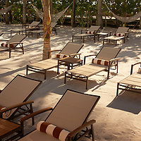 Advertising photograph of the private beach at The Palms Hotel on South Beach, with the beautiful morning light, illuminating the beach chairs.