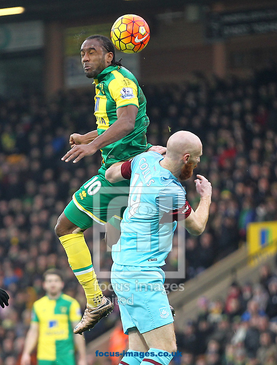 Cameron Jerome of Norwich and James Collins of West Ham in action during the Barclays Premier League match at Carrow Road, Norwich<br /> Picture by Paul Chesterton/Focus Images Ltd +44 7904 640267<br /> 13/02/2016
