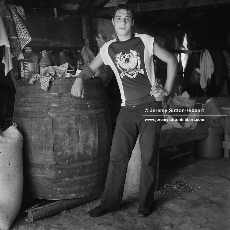 Simione Mihai, in a work shed, in the roma camp of Sintesti, Romania,  September 2004.