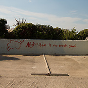 A map of Afghanistan and writing scrawled on the walls of a car park in the Greek city of Patras.