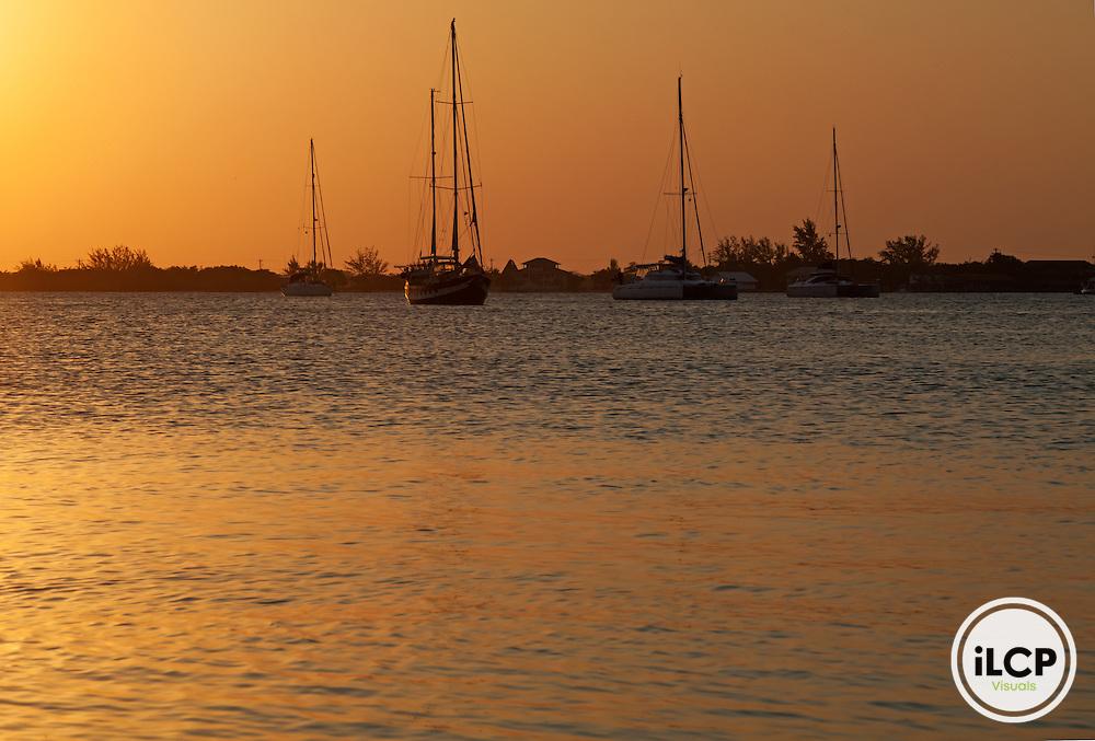 Sailboats at dusk, tourism, Utila Island, Bay Islands, Honduras, April