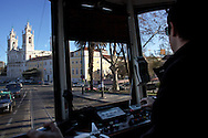 View from the inside of a Lisbon's nº28 yellow tram arriving at Basílica da Estrela, on his way through the central, most historic region of the city.
