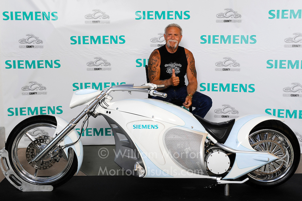 Paul Teutul, Sr. of Orange County Choppers poses with the electric Siemens Smartchopper at the Manchester Grand Hyatt in San Diego. Morton Visuals printed 400 prints on the spot as guests took turns posing with Teutul and the motorcycle. Event photography by Dallas event photographer William Morton.