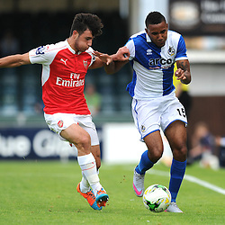 Nathan Blissett of Bristol Rovers challenges for the ball with Arsenal's Savvas Mourgos - Photo mandatory by-line: Dougie Allward/JMP - Mobile: 07966 386802 - 18/07/2015 - SPORT - Football - Bristol - Memorial Stadium - Pre-Season Friendly