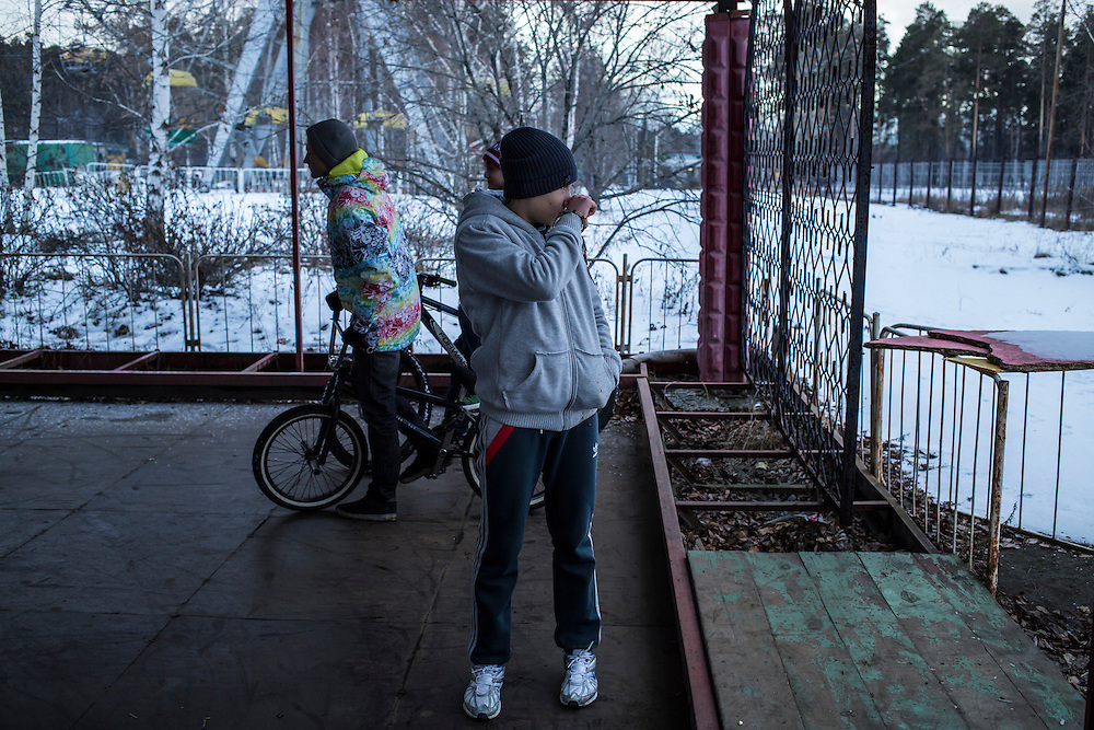 Teenage boys practice tricks on their BMX bicycles on Saturday, November 30, 2013 in Asbest, Russia.