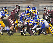 Picayune's Kadarius Cross (5) is tackled by Oxford High's Jimmico Payne (44), Oxford High's Kevin Whitney (47), and Oxford High's J.R. Anderson (32) in the MHSAA Class 5A championship game at Mississippi Veterans Memorial Stadium in Jackson, Miss. on Saturday, December 7, 2013. Picayune rallied to win 42-35.