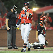 Mississippi's Preston Overbey (1) walks back to the dugout after striking out against Louisiana-Lafayette in an NCAA Super Regional game in Lafayette, La. on Saturday, June 7, 2014.