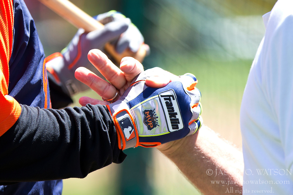 OAKLAND, CA - MAY 26:  Detailed view of Miguel Cabrera #24 of the Detroit Tigers wearing a Franklin batting glove while shaking hands with  broadcaster and former player Ray Fosse of the Oakland Athletics during batting practice before the game at O.co Coliseum on May 26, 2014 in Oakland, California. The Oakland Athletics defeated the Detroit Tigers 10-0.  (Photo by Jason O. Watson/Getty Images) *** Local Caption *** Miguel Cabrera; Ray Fosse