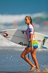 HUNTINGTON BEACH, CA - JULY 19: Alana Blanchard (USA) -- walks off the water after finishing fourth place at the Hurley US Open of Surfing 2009 Nike 6.0 Pro Semi-finals Heat 2. Photo: Eduardo E. Silva