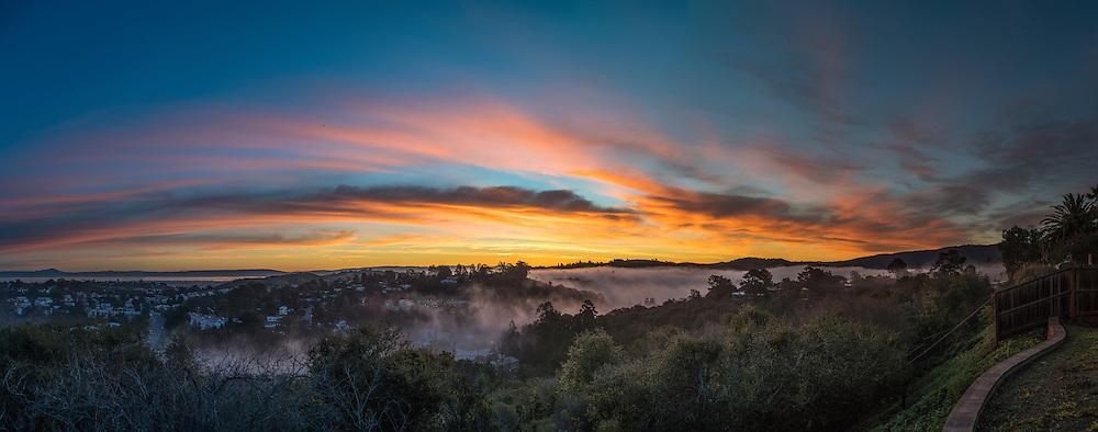 Misty sunrise panorama in San Mateo, California.
