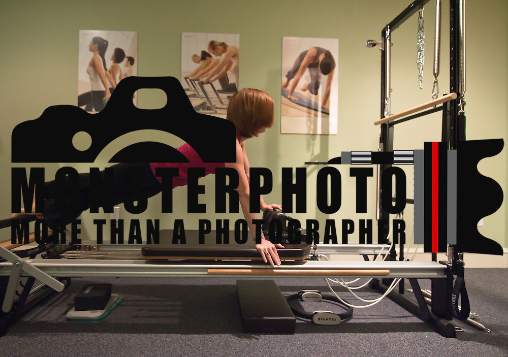 051011 Wilmington DE: 051011-24dh.get.fit-SS. Pilates instructor Patti McKelvey performs the tendon stretch during a private Plates session.<br /> <br /> Special to The News Journal/SAQUAN STIMPSON<br /> <br /> Pilates instructor Patti McKelvey.<br /> http://wwww.pilates.com.