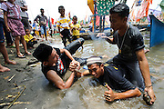 Arm wrestling match on teh beach at the Maulid Nabi festival, Cikoang, Sulawesi, Indonesia.