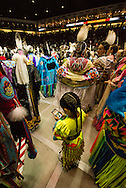 Gathering of Nations Pow Wow, girl plays online with mobile phone, Albuquerque, New Mexico, University of New Mexico