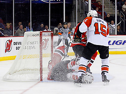 Oct 24, 2008; Newark, NJ, USA; Philadelphia Flyers right wing Joffrey Lupul (15) scores on New Jersey Devils goalie Martin Brodeur (30) during the third period at the Prudential Center. The Flyers defeated the Devils 6-3.