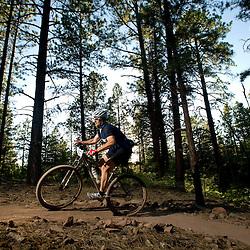The sun begins to set as a racer climbs the Turkey Nest Trail.