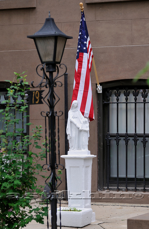 Statue of St Mary and American flag.