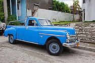 Old car converted into a pickup truck in Santiago de Cuba, Cuba.