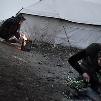 SYRIA, ATMEH. The largest camp for displaced Syrians, seen on January 12, 2013, is on the border with Turkey and is providing shelter to nearly 13,000 people. As there is no heating, as the night falls people try to warm themselves by lighting a small fire..ALESSIO ROMENZI