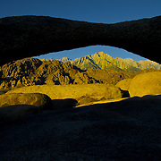 The scenic Alabama Hills nestled against the Eastern Sierra feature fantastic stone arches and wonderful views of Mt. Whitney, highest mountain in the contiguous 48 states. Mt. Whitney is seen through Lathe Arch.