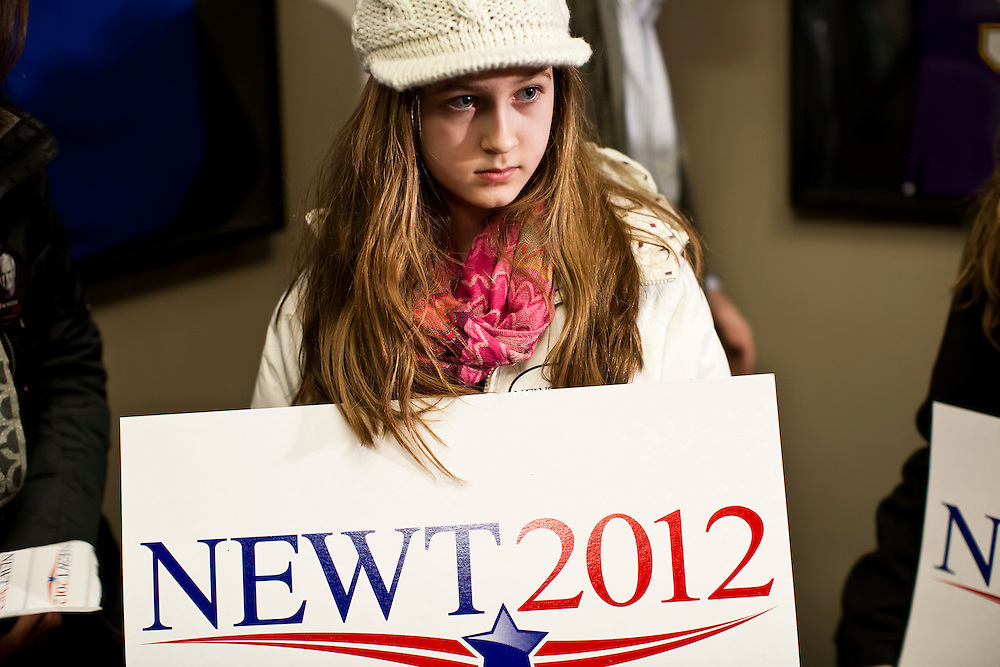 A girl holds a sign for Republican presidential candidate Newt Gingrich before his appearance at Junction Sports Bar & Grill on Sunday, January 1, 2012 in Marshalltown, IA.