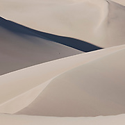 The sand dunes of Great Sand Dunes National Park, Colorado, are the tallest in North America Some of the sand originated from the San Juan Mountains, more than 65 miles west of the national park. Strong winds blow the sand, which piles up at the base of the Sangre de Cristo Mountains.