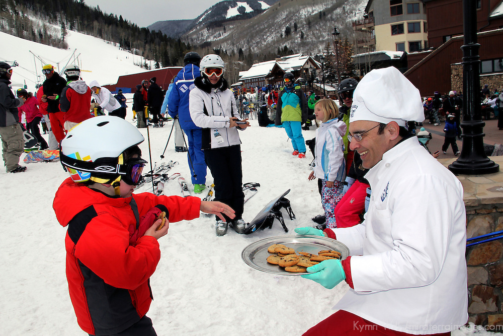 USA, Colorado, Beaver Creek. Chef with freshly baked chocolate chip cookies greets skiiers at Beaver Creek.