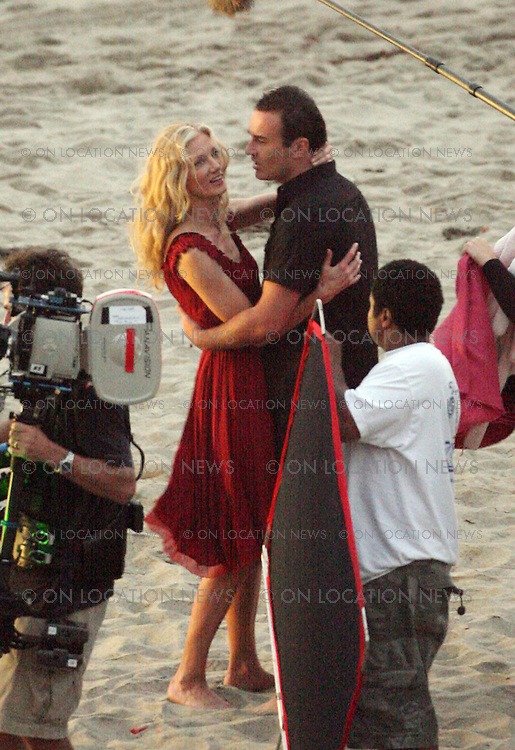 MALIBU, CALIFORNIA - Wednesday 15th August 2007. EXCLUSIVE: Julian McMahon and Joely Richardson film a romantic scene on the beach at sunset for the series Nip/Tuck. In the show these two characters re kindle a bizarre romance Photograph: David Buchan/On Location News. Sales: Eric Ford 1/818-613-3955 info@OnLocationNews.com