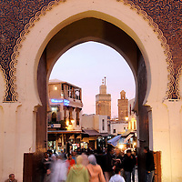 Fes el Bali, Morocco, 25 October 2006<br /> Bab Boujaloud door. <br /> Fes or Fez is the third largest city in Morocco, after Casablanca and Rabat. <br /> It is one of the four so-called &quot;imperial cities&quot;.<br /> The Medina of Fes is believed to be the largest contiguous car-free urban area in the world. <br /> Fes el Bali is classified as a UNESCO World Heritage Site.<br /> Photo: Ezequiel Scagnetti