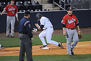 Ole Miss' Zack Kirksey (11) hits an RBI triple at Oxford-University Stadium in Oxford, Miss. on Tuesday, March 1, 2010.