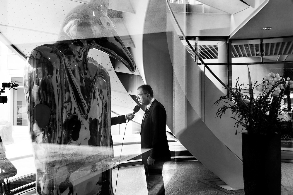 UBS employee being interviewed by a TV station after the announcemnet of annual results, in the lobby of an art-decorated builidng in central Zurich belonging to the bank.