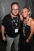August 25, 2012-Brooklyn, NY: Paul Levantino, BaduWorld.com and Ginny Suss, OkayPlayer.com backstage at the Afropunk Festival 2012 held in Brooklyn, NY on August 25, 2012. The Afropunk Festival has become a Brooklyn intuition, the focal point for the burgeoning Afro-punk movement. Over the past seven years, the festival has presented new artists before they hit it big, such as Grammy-nominated Santigold, The Noisettes and Janelle Monae. Afro-punk mainstays like Saul Williams, The Dirtbombs, and Dallas Austin have also graced Afro-punk's stages. (Terrence Jennings/TerrenceJennings.com)