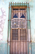 Window and birdcage in Cardenas, Matanzas, Cuba.