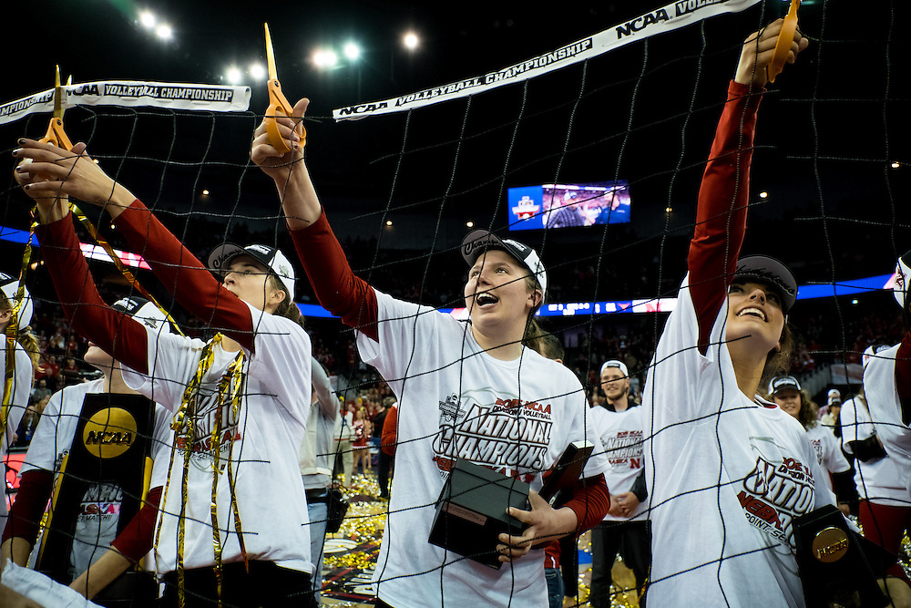 OMAHA, NE - DECEMBER 19: outside hitter Mikaela Foecke #2, libero/defensive specialist Kenzie Maloney #11 and the Nebraska Cornhuskers cut the net after winning the NCAA finals match against the Texas at the CenturyLink Center on December 19, 2015 in Omaha, Nebraska.  (Photo by Eric Francis)