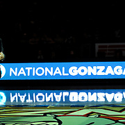 "Woo Kim '12 speaks during the National Gonzaga Day ""Global Education, Global Celebration"" Halftime Program"