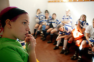 Girl from Tecnico team biting her nails during her trainer speech before a National League match.