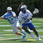 Duke Midfielder Myles Jones (15), RIGHT, attempts to pass the ball as Johns Hopkins defenseman Robert Enright (38), LEFT, defends during the second half of The NCAA Division I Men's Lacrosse Tournament game between the Defending national champion Duke and No. 8 ranked Johns Hopkins Sunday, May. 18, 2014 at Delaware Stadium in Newark, DEL