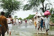 Muzzafargarh: Residents fleeing rising floodwater near the town of Baseera in the district of Muzzafargarh...Flood waters continued to cause havoc in South Punjab.