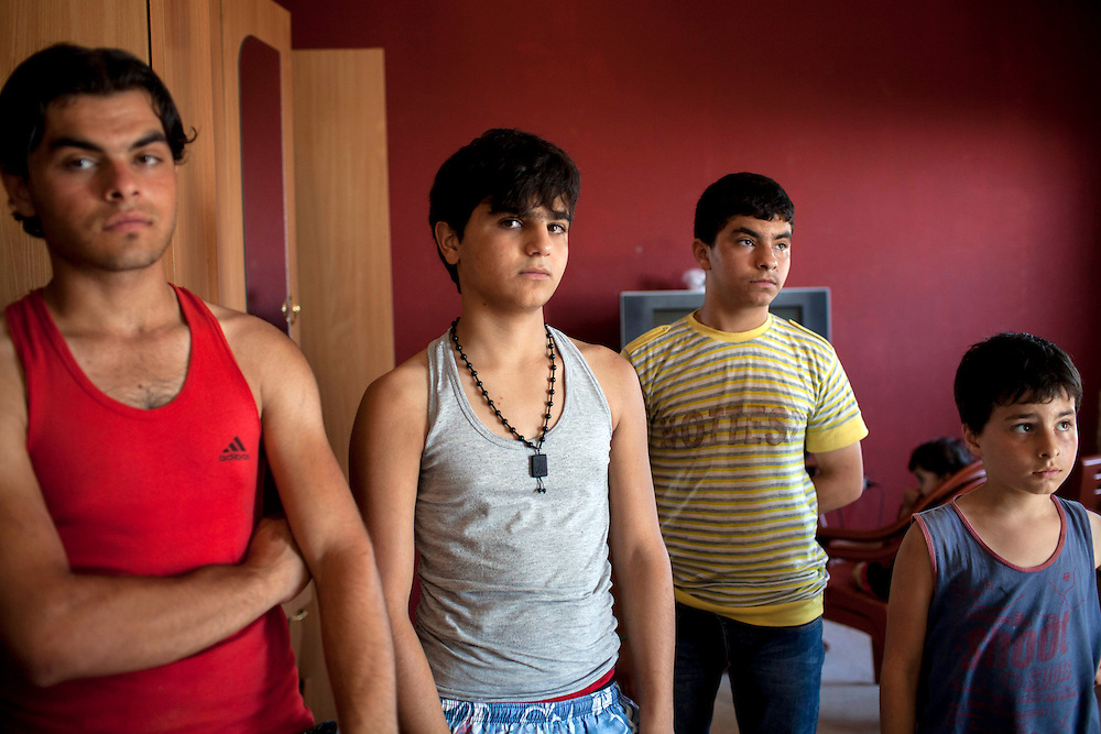 05/07/2013 near Damour, Lebanon: Young men who fled Syria from Idlib pose for a portrait inside the home they share with three families. Estimates have placed the number of Syrian refugees in Lebanon at well over 500,000 people.