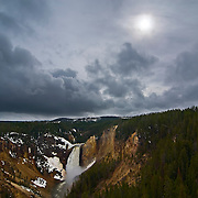 Thunderstorm clouds over Lower Yellowstone Falls in Yellowstone National Park, Wyoming.