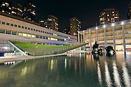 Lincoln Center, Illumination Lawn, a sloping green public lawn designed by Diller Scofidio & Renfro's,  Henry Moore's Reclining Figure, North Plaza, Manhattan,New York City, New York, USA