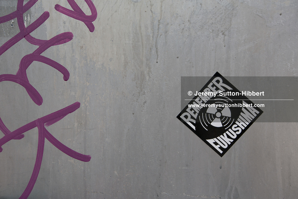 Anti-nuclear and Anti-TEPCO street art stickers, in Tokyo, Japan, Tuesday 10th April 2012.