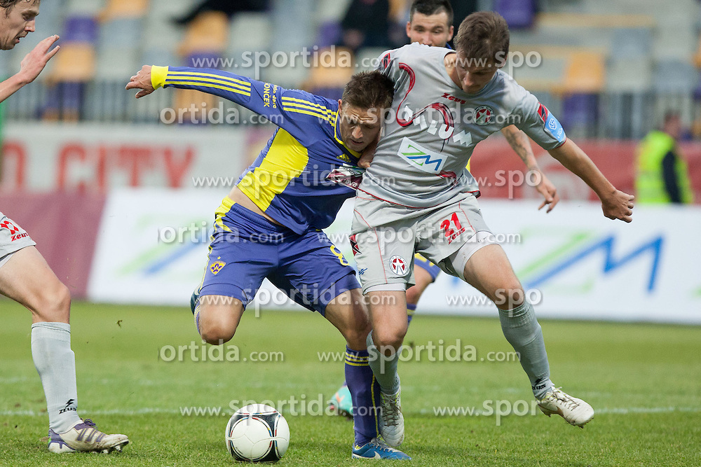 Dejan Mezga #8 of Maribor and David Kasnik #21 of NK Aluminij during football match between NK Maribor and NK Aluminij in 18th Round of Slovenian First League PrvaLiga NZS 2012/31 on November 7, 2012 in Ljudski vrt, Maribor, Slovenia. (Photo By Gregor Krajncic / Sportida)