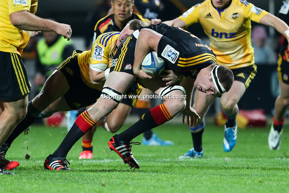 Chiefs' Brodie Retallick with a strong carry during the Super 15 Rugby match - Chiefs v Hurricanes at Waikato Stadium, Hamilton, New Zealand on Friday 4 July 2014.  Photo:  Bruce Lim / www.photosport.co.nz