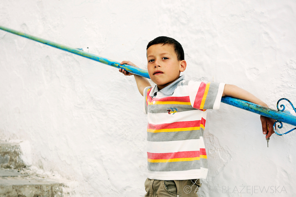 Morocco, Chefchaouen. Portrait of a boy in a striped t-shirt.