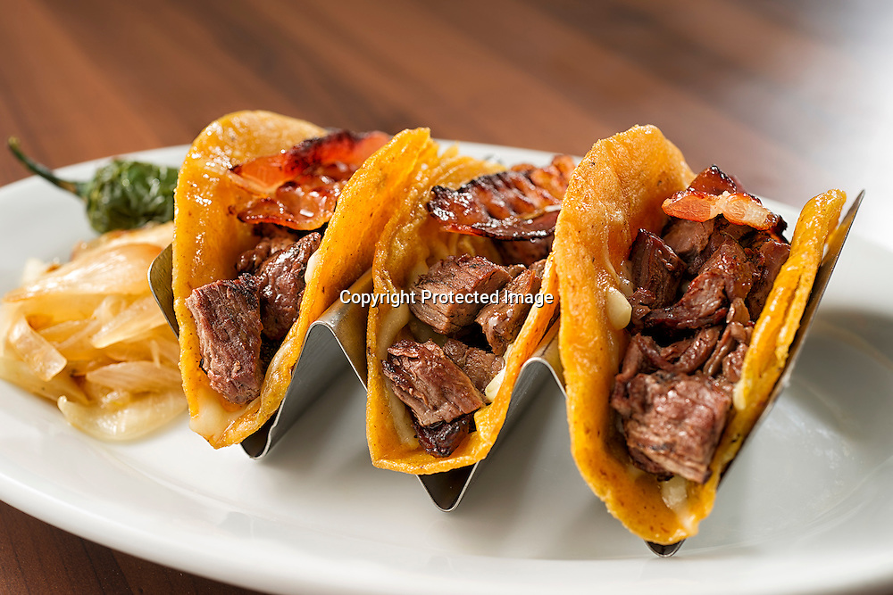Arrachera Tacos with bacon and melted cheese with side of grilled onion and fried jalapeno.