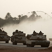 Armored tanks and fighting vehicles from the U.S. Army 3rd Division reach Baghdad April 02, 2003 and move to take the international airport.